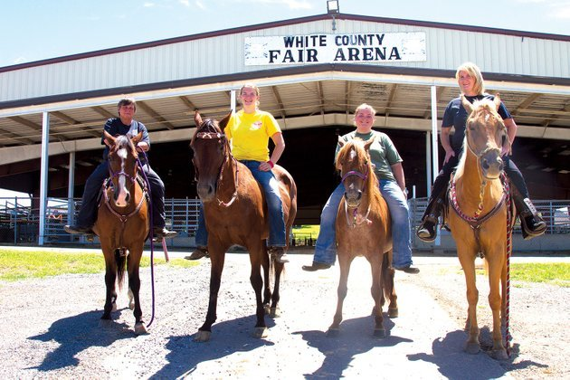 from-left-cookie-jackson-brooklyn-duncan-jeri-augustine-and-beverly-duncan-sit-on-from-left-peanut-ruby-ann-sierra-and-edie-in-preparation-for-the-white-county-sheriffs-mounted-patrol-horse-show