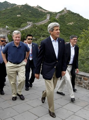 U.S. Secretary of State John Kerry, center, U.S. Ambassador to China Max Baucus, left, and Treasury Secretary Jack Lew, right, climb to the top of the Badaling Section of the Great Wall of China in Beijing, China, Tuesday, July 8, 2014.
