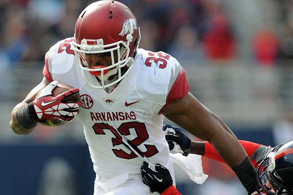 arkansas-jonathan-williams-left-slips-past-a-defender-saturday-nov-9-2013-during-the-second-quarter-of-the-game-against-ole-miss-at-vaught-hemingway-stadium-in-oxford-miss