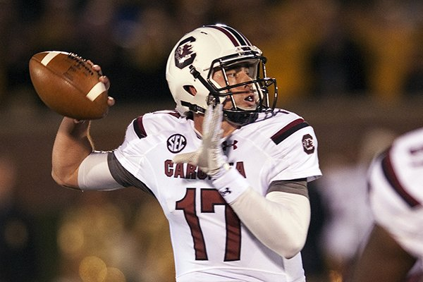 In this Oct. 26, 2013 file photo, South Carolina quarterback Dylan Thompson throws a pass during the first quarter of an NCAA college football game against Missouri, in Columbia, Mo. (AP Photo/L.G. Patterson, File)