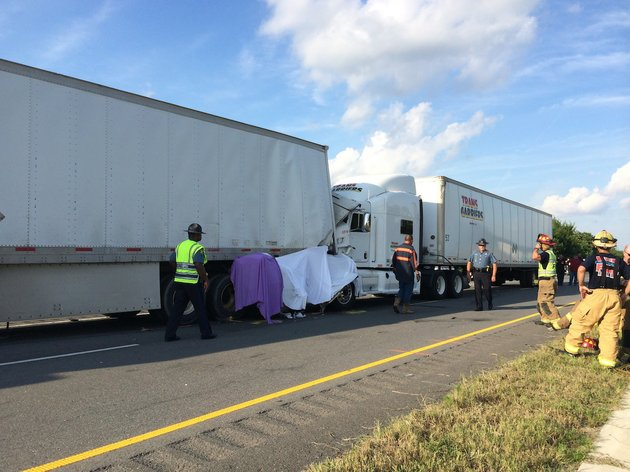 emergency-officials-respond-to-the-scene-of-an-accident-wednesday-afternoon-on-interstate-40-involving-three-tractor-trailers-and-a-white-cadillac