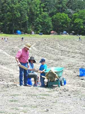 A family digs together in the 37-acre gem field at Crater of Diamonds State Park, two miles southeast of Murfreesboro.