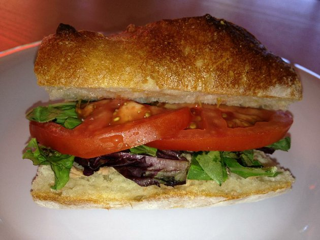 a-half-serving-of-a-tuna-sandwich-comes-on-a-richly-textured-hoagie-roll-at-cafe-brunelle