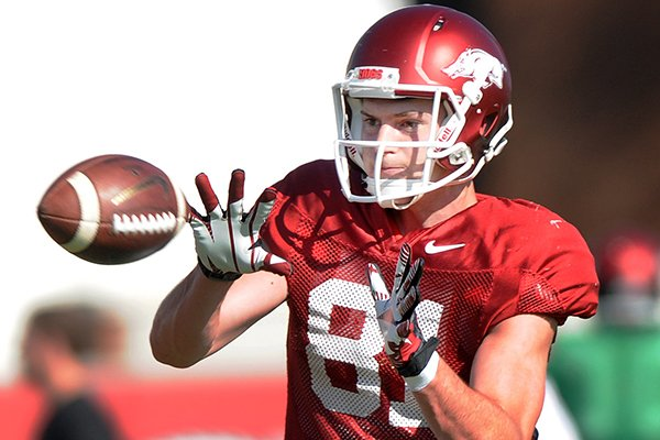 Cody Hollister catches the ball at spring football practice Tuesday, April 22, 2014, at University of Arkansas in Fayetteville