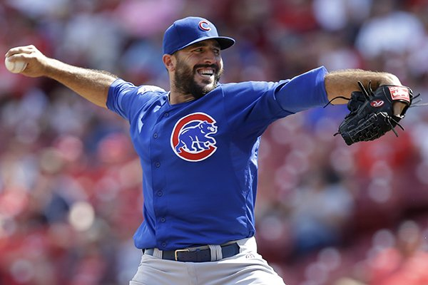 Chicago Cubs relief pitcher Blake Parker throws against the Cincinnati Reds in the 12th inning of a baseball game, Thursday, July 10, 2014, in Cincinnati. Parker was the winning pitcher in the game won by Chicago 6-4 in 12 innings. (AP Photo/Al Behrman)