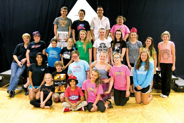 the-cast-of-aladdin-jr-gathers-after-a-day-of-rehearsal-at-the-central-arkansas-performing-arts-academy-in-cabot