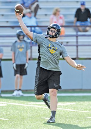 STAFF PHOTO ANDY SHUPE Dylan Soehner, Prairie Grove quarterback, makes a pass attempt while playing 7-on-7 Monday at Jarrell Williams Bulldog Stadium in Springdale.