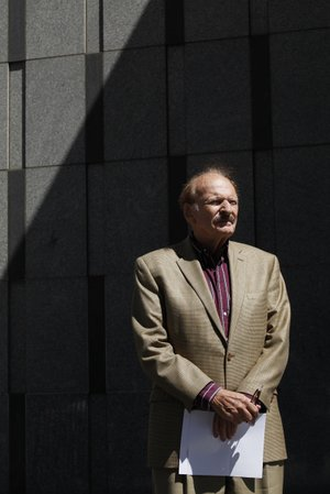 James Prigoff stands in front of the San Francisco Federal Building waiting for a news conference to begin on Thursday, July 10, 2014. Prigoff is one of several California men suing the Department of Justice over an information-sharing program designed to help flag potential terrorism activity. Prigoff said he was visited at his California home by a member of a joint-terrorism task force months after trying to photograph a piece of public art in Boston on a natural gas storage tank.