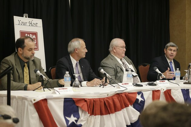 candidates-for-arkansas-governor-from-left-green-party-joshua-drake-republican-asa-hutchinson-libertarian-frank-gilbert-and-democrat-mike-ross-participate-in-a-debate-at-the-arkansas-press-association-convention-in-hot-springs-ark-friday-july-11-2014