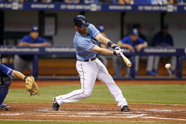 Tampa Bay Rays' Logan Forsythe follows through on a single that scored Yunel Escobar during the second inning of a baseball game against the Toronto Blue Jays on Sunday, July 13, 2014, in St. Petersburg, Fla. The Rays won 3-0. (AP Photo/Mike Carlson)