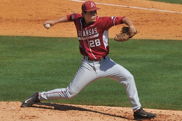 Arkansas pitcher James Teague fires a pitch against Ole Miss in the 2014 SEC baseball tournament at the Hoover Met in Hoover, Alabama.