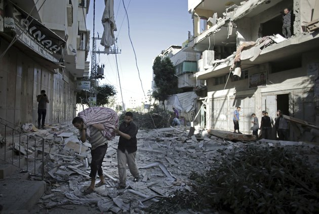 palestinians-salvage-what-they-can-of-their-belongings-from-the-rubble-of-their-destroyed-house-after-an-early-morning-israeli-missile-strike-in-gaza-city-on-wednesday-july-16-2014-a-hamas-website-says-israel-has-fired-missiles-at-the-homes-of-four-of-its-senior-leaders-as-it-resumed-bombardment-of-gaza-after-a-failed-egyptian-cease-fire-effort