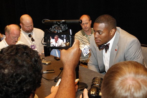 arkansas-defensive-end-trey-flowers-speaks-to-media-at-the-southeastern-conference-ncaa-college-football-media-days-on-wednesday-july-16-2014-in-hoover-ala-ap-photobutch-dill