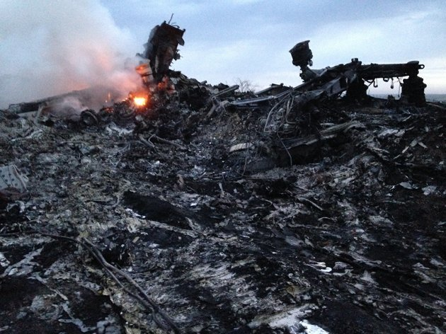 smoke-rises-up-at-a-crash-site-of-a-passenger-plane-near-the-village-of-hrabove-ukraine-thursday-july-17-2014-a-ukrainian-official-said-a-passenger-plane-carrying-295-people-was-shot-down-thursday-as-it-flew-over-the-country-and-plumes-of-black-smoke-rose-up-near-a-rebel-held-village-in-eastern-ukraine-malaysia-airlines-tweeted-that-it-lost-contact-with-one-of-its-flights-as-it-was-traveling-from-amsterdam-to-kuala-lumpur-over-ukrainian-airspace