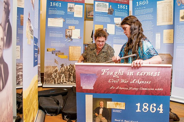 lynita-langley-ware-left-with-help-from-her-daughter-sophia-sets-up-one-of-the-panels-of-a-traveling-civil-war-exhibit-at-the-faulkner-county-museum-in-conway