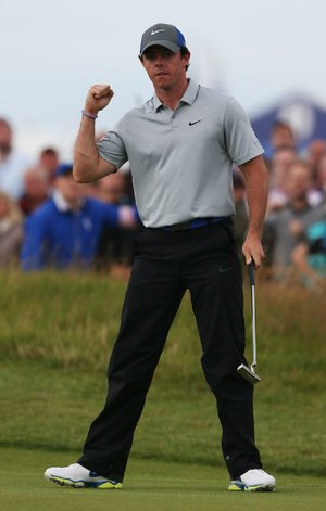 Rory McIlroy, who leads the British Open by six shots after three rounds, celebrates an eagle on No. 16 at Royal Liverpool on Saturday. McIlroy has led the tournament through all three rounds and added another eagle on No. 18 to go with three bogeys.