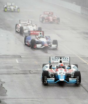 Canada's James Hinchcliffe (27) leads the field around the track under a caution flag ahead of what was supposed to be the first IndyCar auto race of a weekend doubleheader in Toronto on Saturday.
