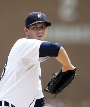 Detroit Tigers starting pitcher Drew Smyly throws during the first inning of a baseball game against the Cleveland Indians, Sunday, July 20, 2014 in Detroit. (AP Photo/Carlos Osorio)