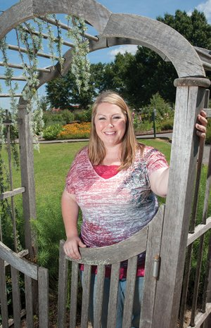 Kami Marsh, an agriculture agent with the Faulkner County Cooperative Extension Service, stands in Legacy Gardens at the Faulkner County Natural Resource Center in Conway. Marsh, 32, said a friend in Nebraska who was from Harrison alerted her to the job in Conway in 2006, a new position as an extension agent focused on horticulture. The extension service provides free testing, information and classes for homeowners and commercial growers.