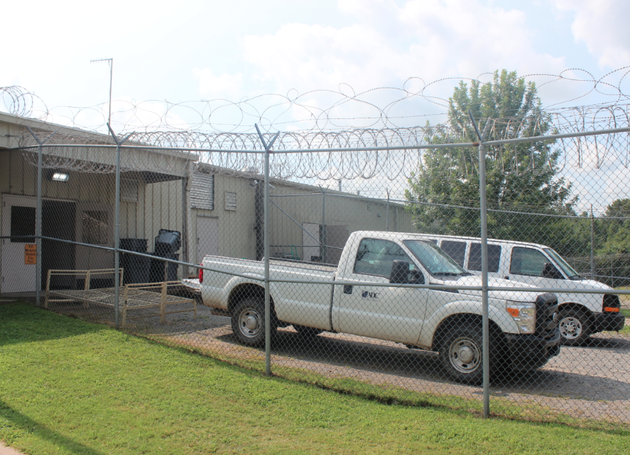 arkansas-department-of-correction-vehicles-sit-outside-the-former-pulaski-county-sheriffs-office-work-center-monday-shortly-after-the-state-agreed-to-lease-the-facility-to-house-some-state-inmates