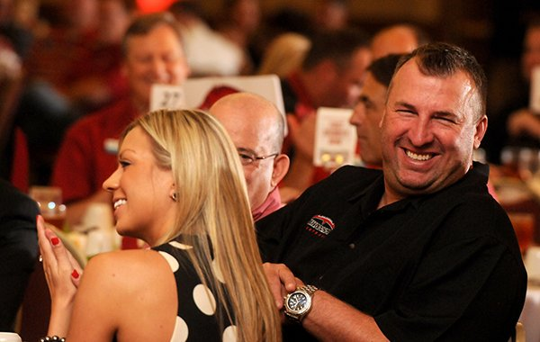Arkansas head football coach Bret Bielema, right, with his wife Jen Bielema at the Razorback Football Kickoff Luncheon Friday, Aug. 23, 2013 at the Northwest Arkansas Convention Center in Springdale. The event featured the entire football team spread out to the various tables and head football coach Bret Bielema.