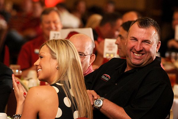 arkansas-head-football-coach-bret-bielema-right-with-his-wife-jen-bielema-at-the-razorback-football-kickoff-luncheon-friday-aug-23-2013-at-the-northwest-arkansas-convention-center-in-springdale-the-event-featured-the-entire-football-team-spread-out-to-the-various-tables-and-head-football-coach-bret-bielema