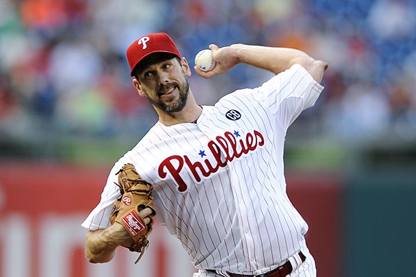 Philadelphia Phillies starting pitcher Cliff Lee throws a pitch during the first inning of a baseball game against the San Francisco Giants on Monday, July 21, 2014, in Philadelphia. (AP Photo/Michael Perez)
