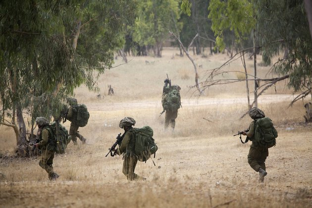 israeli-soldiers-march-during-a-drill-near-the-israel-and-gaza-border-tuesday-july-22-2014-israeli-airstrikes-pummeled-a-wide-range-of-targets-in-the-gaza-strip-on-tuesday-as-the-un-chief-and-the-us-secretary-of-state-began-an-intensive-effort-to-end-more-than-two-weeks-of-fighting-that-has-killed-hundreds-of-palestinians-and-dozens-of-israelis