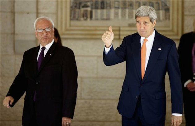 us-secretary-of-state-john-kerry-right-and-chief-palestinian-negotiator-saeb-erekat-arrive-to-a-meeting-with-palestinian-president-mahmoud-abbas-in-the-west-bank-city-of-ramallah-on-wednesday-july-23-2014