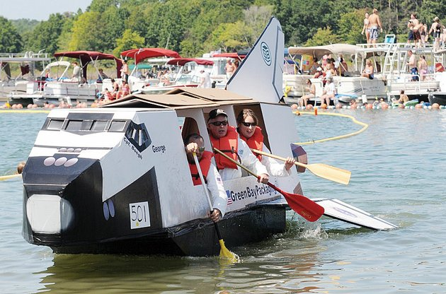 a-team-from-green-bay-packaging-heads-for-the-finish-line-in-last-years-world-championship-cardboard-boat-races-on-greers-ferry-lake-in-heber-springs-this-years-event-will-start-at-10-am-saturday-on-sandy-beach-and-will-feature-several-other-activities-including-watermelon-eating-and-sand-sculpting-contests-and-beach-volleyball