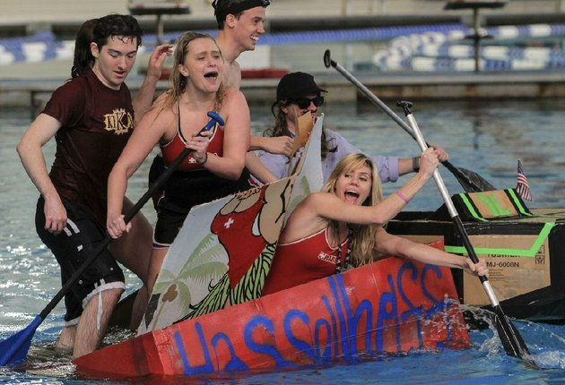 arkansas-democrat-gazettebenjamin-krain-3714-ualr-lifeguards-from-left-alex-hall-meagan-tate-nate-carr-adrian-hubbard-and-lauren-farrell-collide-cardboard-boats-as-they-try-to-stay-afloat-during-the-the-ualr-homecoming-great-cardboard-boat-regatta-on-friday-students-representing-campus-organizations-competed-for-various-awards-during-the-competition-more-photos-online-focus-gallery