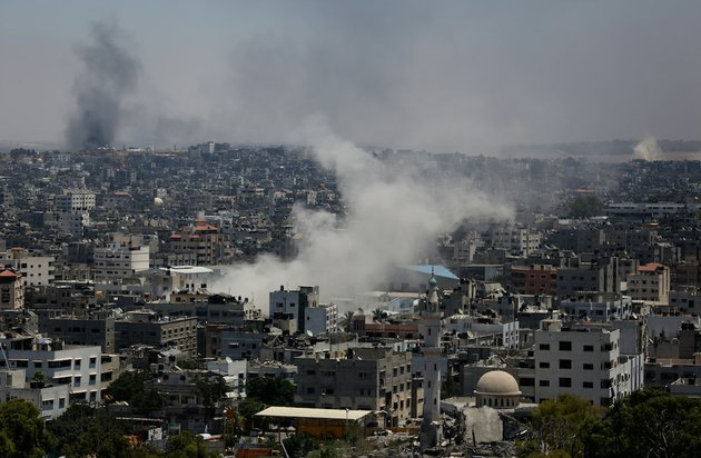 smoke-from-an-israeli-strike-rises-over-gaza-city-on-thursday-july-24-2014-israeli-tanks-and-warplanes-bombarded-the-gaza-strip-on-thursday-as-hamas-militants-stuck-to-their-demand-for-the-lifting-of-an-israeli-and-egyptian-blockade-in-the-face-of-us-efforts-to-reach-a-cease-fire