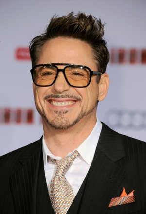 "FILE - In this April 24, 2013 file photo, actor Robert Downey Jr. arrives at the world premiere of ""Marvel's Iron Man 3"" at the El Capitan Theatre, in Los Angeles. The Toronto Film Festival unveiled a star-heavy lineup amid increased festival jockeying for the most plum premieres of Hollywoods fall season. Torontos slate, announced in a press conference Tuesday, July 22, 2014, in Toronto, features anticipated performances from Denzel Washington, Reese Witherspoon, Downey Jr. and Benedict Cumberbatch, as well as films from directors like Chris Rock, Noah Baumbach and Jon Stewart, making his debut behind the camera. (Photo by Jordan Strauss/Invision/AP, file)"