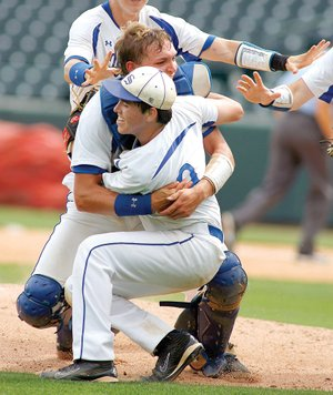 South Side Bee Branch High School catcher Josh Payne, top, tackles pitcher Brian Dumas on May 23 at Baum Stadium in Fayetteville following the team's win over Armorel High School in the Class A state championship baseball game.