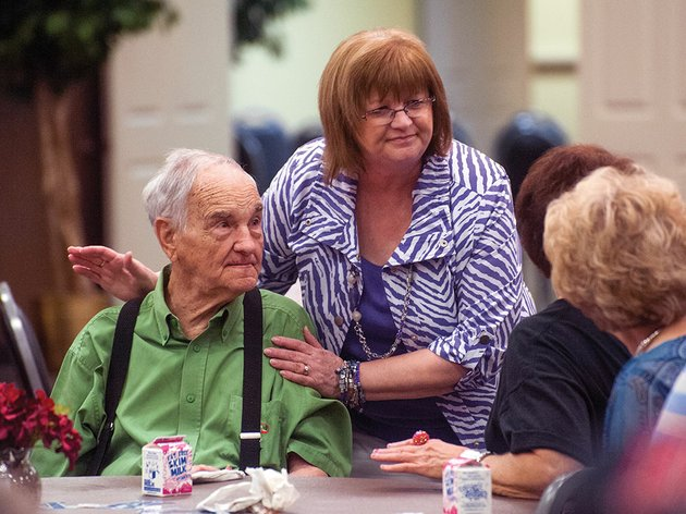 paulette-womack-center-pats-bobby-green-on-the-shoulder-during-the-grand-opening-wednesday-of-the-conway-senior-wellness-and-activity-center-green-was-celebrating-his-86th-birthday-by-eating-lunch-at-the-center-in-its-new-location-on-siebenmorgen-road