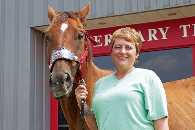kristie-coley-program-director-for-the-veterinary-technology-program-at-arkansas-state-university-beebe-stands-with-goose-one-of-the-programs-horses