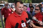 Bret Bielema, Arkansas football coach, speaks to the media prior to the George Billingsley NWA Razorback Club Celebrity Scramble golf tournament at the Kingsdale Golf Complex in Bella Vista on Friday, July 25, 2014.