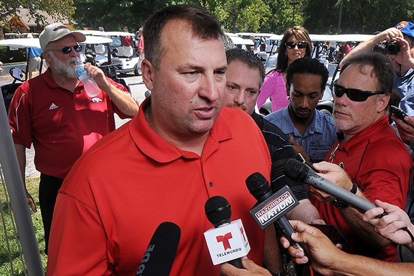 bret-bielema-arkansas-football-coach-speaks-to-the-media-prior-to-the-george-billingsley-nwa-razorback-club-celebrity-scramble-golf-tournament-at-the-kingsdale-golf-complex-in-bella-vista-on-friday-july-25-2014