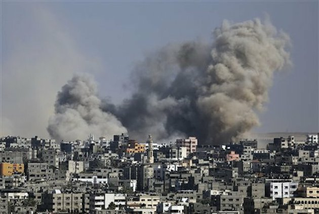 smoke-from-an-israeli-strike-rises-over-the-gaza-strip-on-friday-july-25-2014-israeli-warplanes-struck-houses-throughout-the-gaza-strip-as-international-efforts-continue-to-broker-a-cease-fire-in-the-18-day-old-war