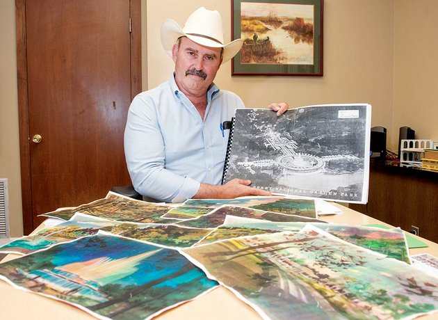 cleburne-county-judge-jerry-holmes-holds-one-of-the-drawings-from-the-1960s-for-fountains-and-gardens-near-the-greers-ferry-dam-in-heber-springs-the-project-started-as-the-idea-of-a-heber-springs-businessman-who-fell-in-love-with-gardens-in-italy-and-proposed-the-idea-to-his-friend-sen-j-william-fulbright-of-arkansas-president-john-f-kennedy-at-the-dam-dedication-in-1963-gave-the-go-ahead-for-plans-for-the-project-to-be-drawn-holmes-said-but-was-assassinated-a-few-weeks-later-the-project-has-been-resurrected-by-holmes-and-billy-lindsey-of-heber-springs-the-men-said-the-project-has-support-from-federal-state-and-local-officials