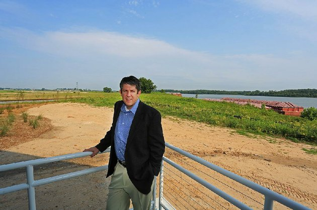 bryan-day-new-executive-director-of-the-little-rock-port-authority-stands-outside-his-office-at-the-nearly-completed-headquarters-for-the-port-authority-along-the-arkansas-river
