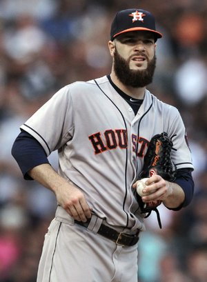 Houston Astros starting pitcher Dallas Keuchel reacts to giving up two runs during the third inning of a baseball game against the Chicago White Sox in Chicago, Saturday, July 19, 2014. (AP Photo/Paul Beaty)