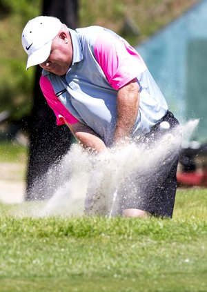 Arkansas Democrat-Gazette/Melissa Sue Gerrits - 07/25/2014 - Tracy Harris hits his ball out of a sand trap on the 7th hole during the first round of the Maumelle Classic July 25, 2014 at the Maumelle Country Club.