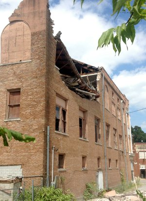 The top floor at the rear of the vacant, three-story building at 602 Main St. in Pine Bluff collapsed Friday prompting authorities to close off the street between Sixth and Eighth avenues as a safety precaution.