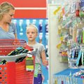 STAFF PHOTO JASON IVESTER Mandi Fahey and her daughter Camille Fahey, 8, both of Rogers, shop Wednes...