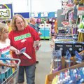 STAFF PHOTO ANTHONY REYES • @NWATONYR Beverly Draper of Springdale shops Friday for school sup...