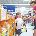 STAFF PHOTO ANTHONY REYES • @NWATONYR Cynthia Bradley of Springdale shops Friday for school su...