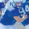STAFF PHOTO SAMANTHA BAKER • @NWASamantha Tanner Campbell breaks through the offensive line d...