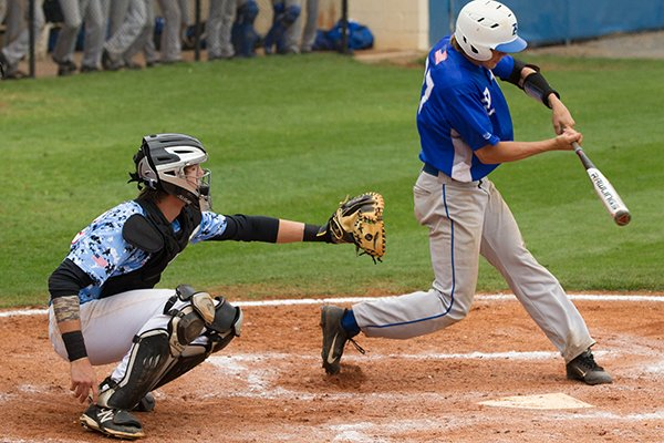Fort Smith Southside catcher Mark Clark watches as Bryant's Dalton Holt records a hit during a state playoff game May 17, 2014 in Conway.
