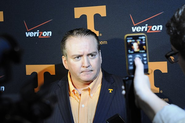 Vols head basketball coach Donnie Tyndall answers questions from the media Monday, May 19, 2014 during the Big Orange Caravan appearance at The Chattanoogan.